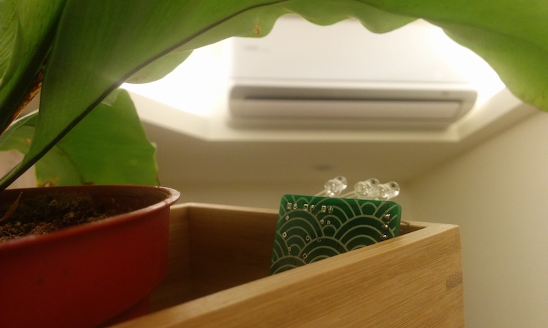 PCB hiding in planter looking at aircon