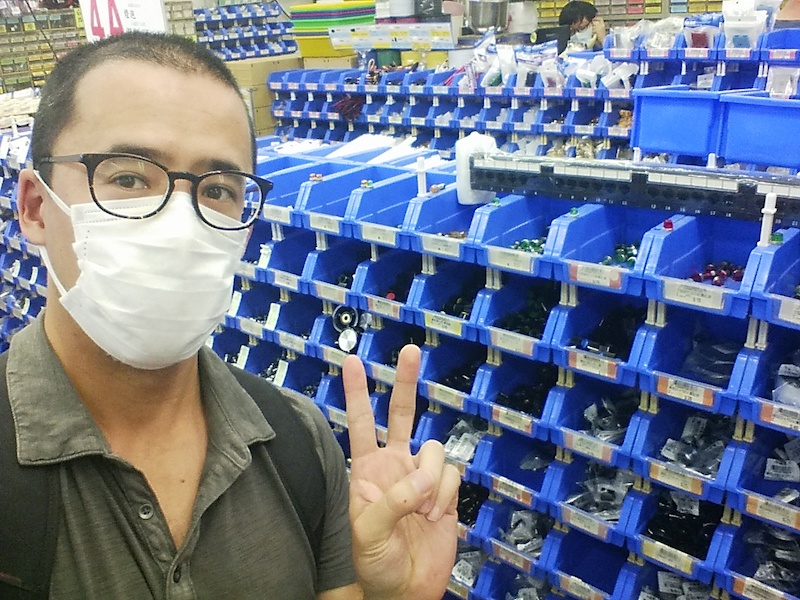 Kevin at the electronics store, surrounded by bins of components